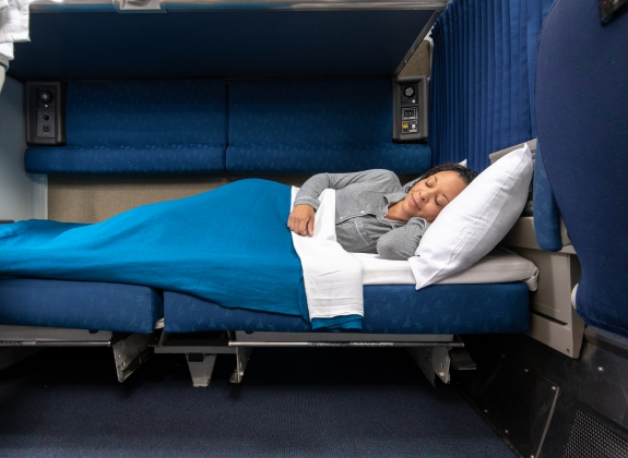 woman laying down in amtrak bedroom