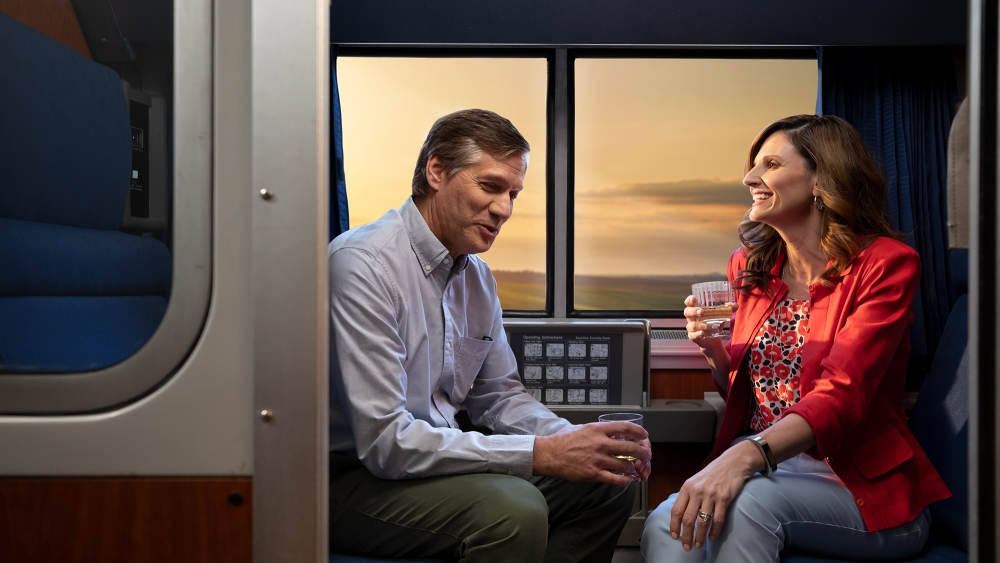 a couple in a private sleeping room onboard amtrak